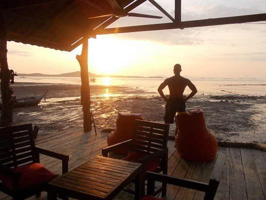Me watching the sunrise from the back deck in Koh Lanta, Thailand. A rare non selfie. Thanks Kelli.