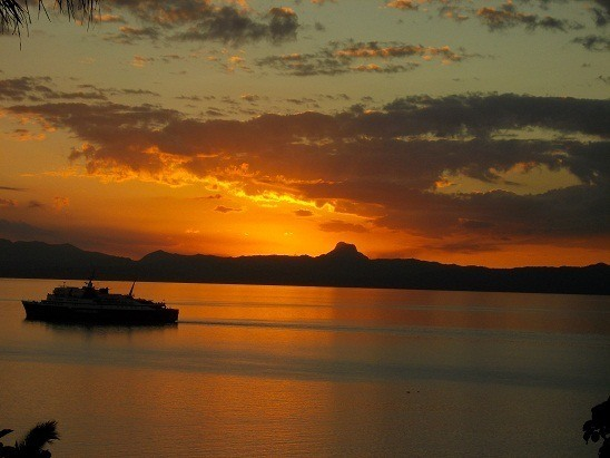 I snapped this postcard-type shot from our front yard in Savusavu, Fiji last night. Thank you, ferry. Perfect timing.