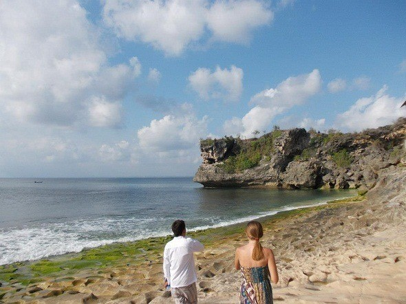 How pretty is Bali? Kelli and our friend Agram strolling on the beach.