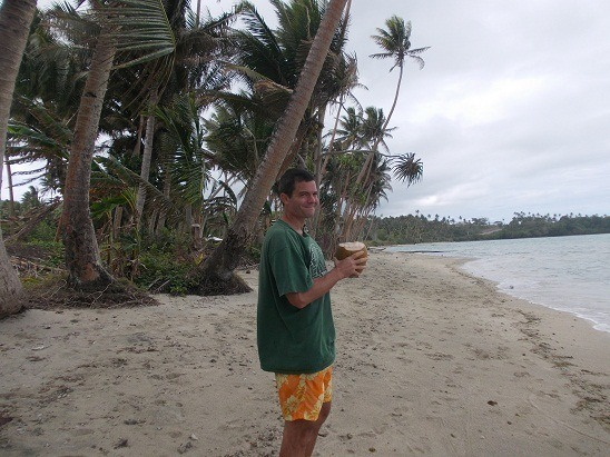 I'm downing fresh coconut juice on the beach here in Nagigi, Fiji.