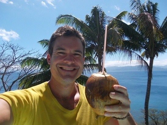 Hand picked coconut, by your truly. Fresh coconut juice, anybody? Me in Savusavu, Fiji on the front deck.