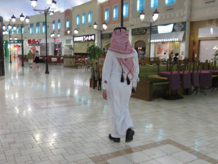 Rocking mall in Doha, Qatar. Qatari man strolling through this Venice-themed mall housing an amusement park, ice skating rink - we saw a pro hockey match one day - and also an ample amount of stores. Plus canals and Gondolas. Like Venice. In Italy. But indoors, in Qatar.