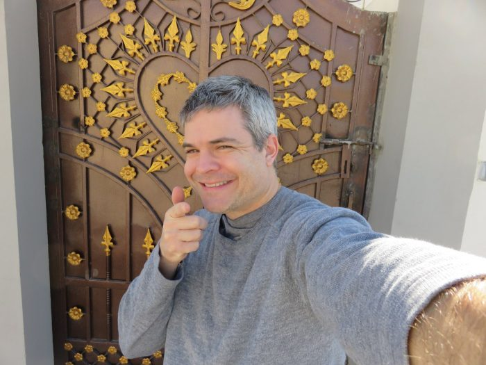 Me in front of the compound in Nizwa, Oman. Peep the detail on that door.