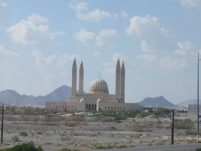 Mosque in Nizwa, Oman. This mosque is particularly eye-popping, with sky high minarets requiring flashing lights to alert airplane pilots.