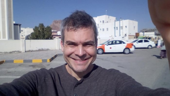 Hand obscured selfie in Nizwa, Oman. Check out the taxi in the background. We learned today how striped taxis are drivers in training and the rest are pro taxi drivers.